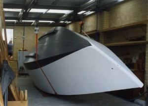 The big moment arrives and the finished hull is rolled over using a lay shafts and pulley technique in the workshop<br />