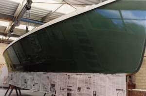 The topsides glisten following application of the gloss topcoats. Klaus used two pack after initially finding that single pack paint was not hard enough.<br />